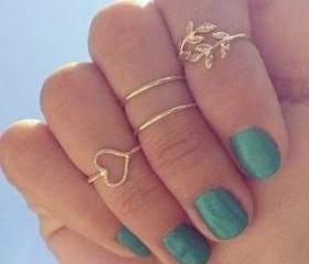 4 pcs knuckle rings ..